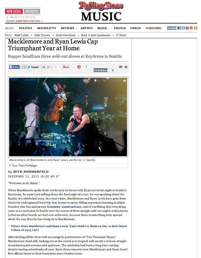 Macklemore performing live in Seattle at Key Arena concert photo